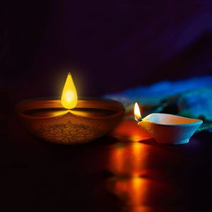 Enlite10 candle next to traditional diwali candle