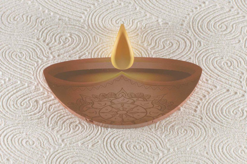 Enlite10 candle laying in zen Garden